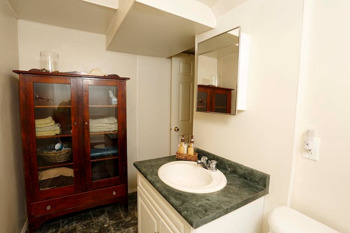 Clean bathroom and a tidy linen cupboard