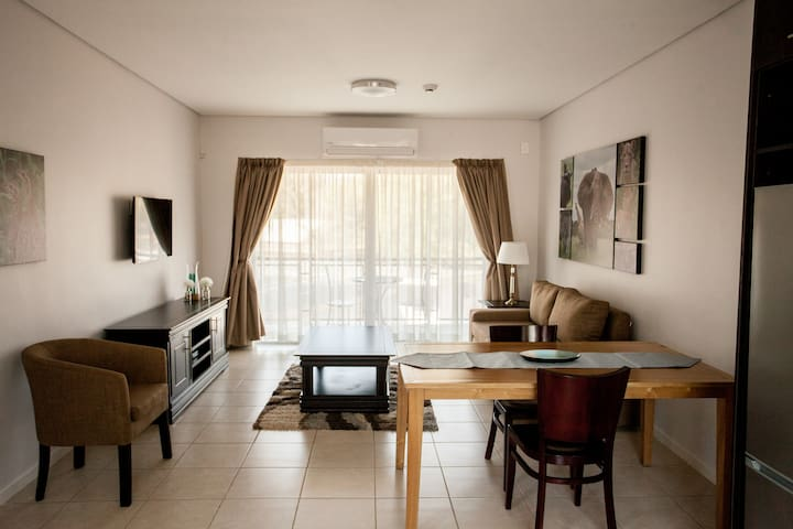 Apartments @ 125 - Unit 1; dining area & lounge including smart enabled TV