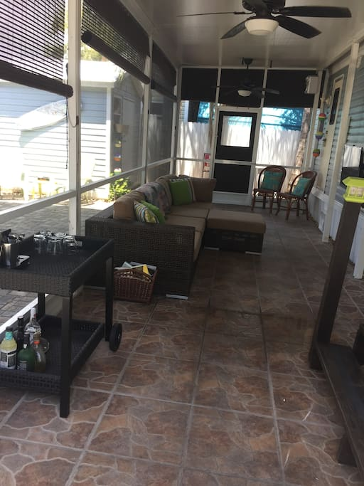 Screened-In Patio with Sectional Sofa & TV