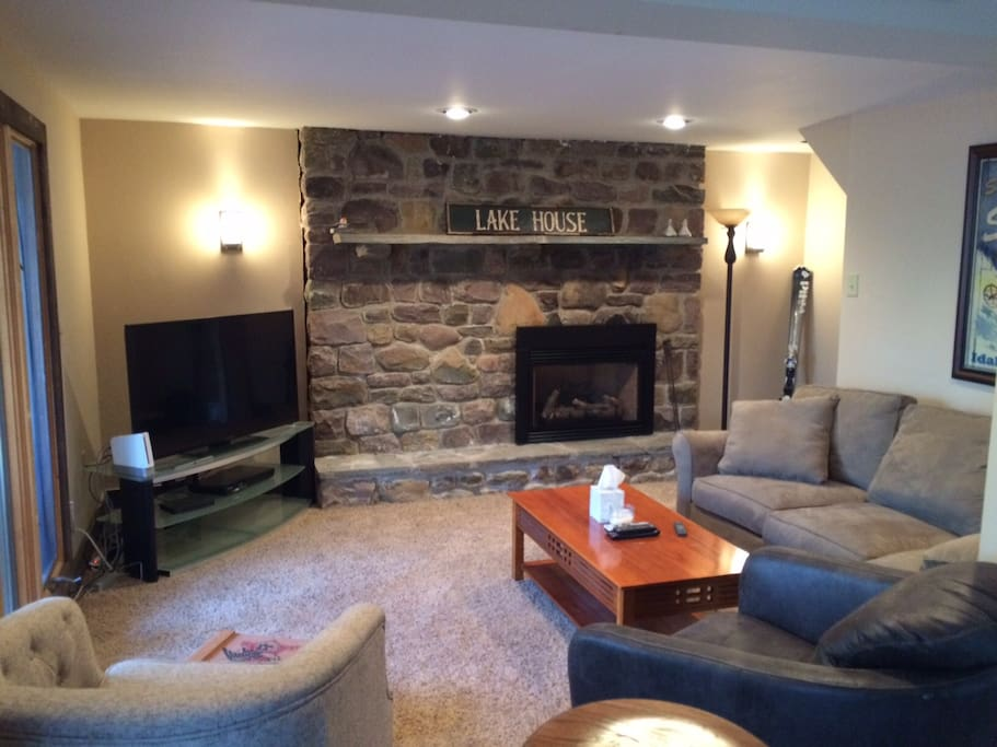 Lower level Game Room and living space with gas fireplace, 55in HDTV and Blue Ray with Smart access functions.