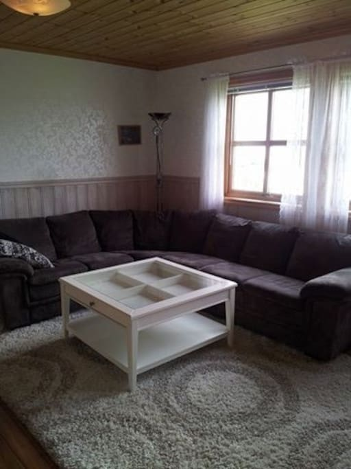 big lovely sofa at one end of the living room