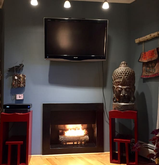Enjoy the fireplace from the couch