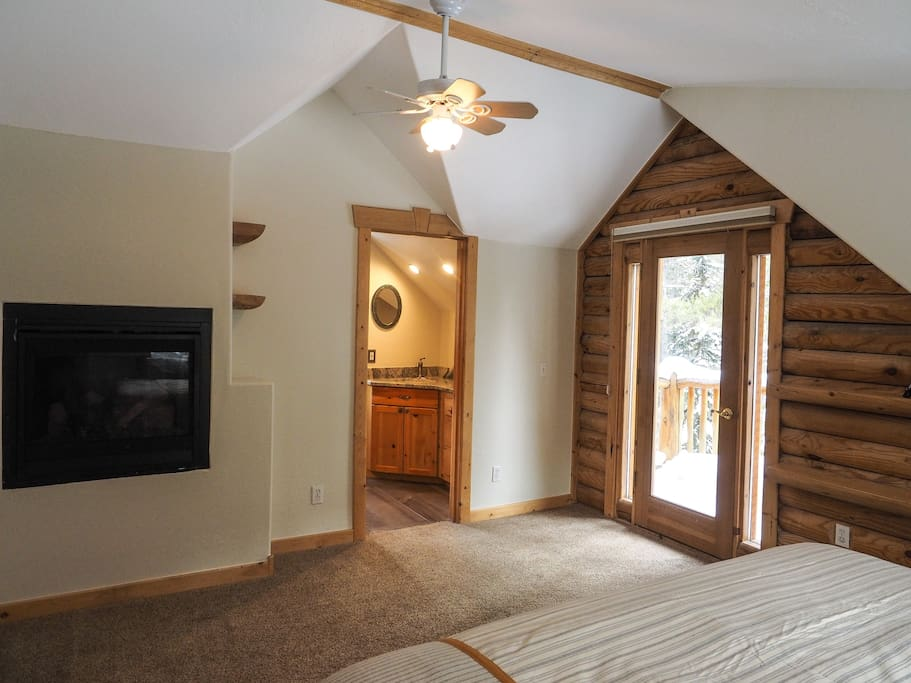 Gas fireplace in master bedroom, and door to small balcony