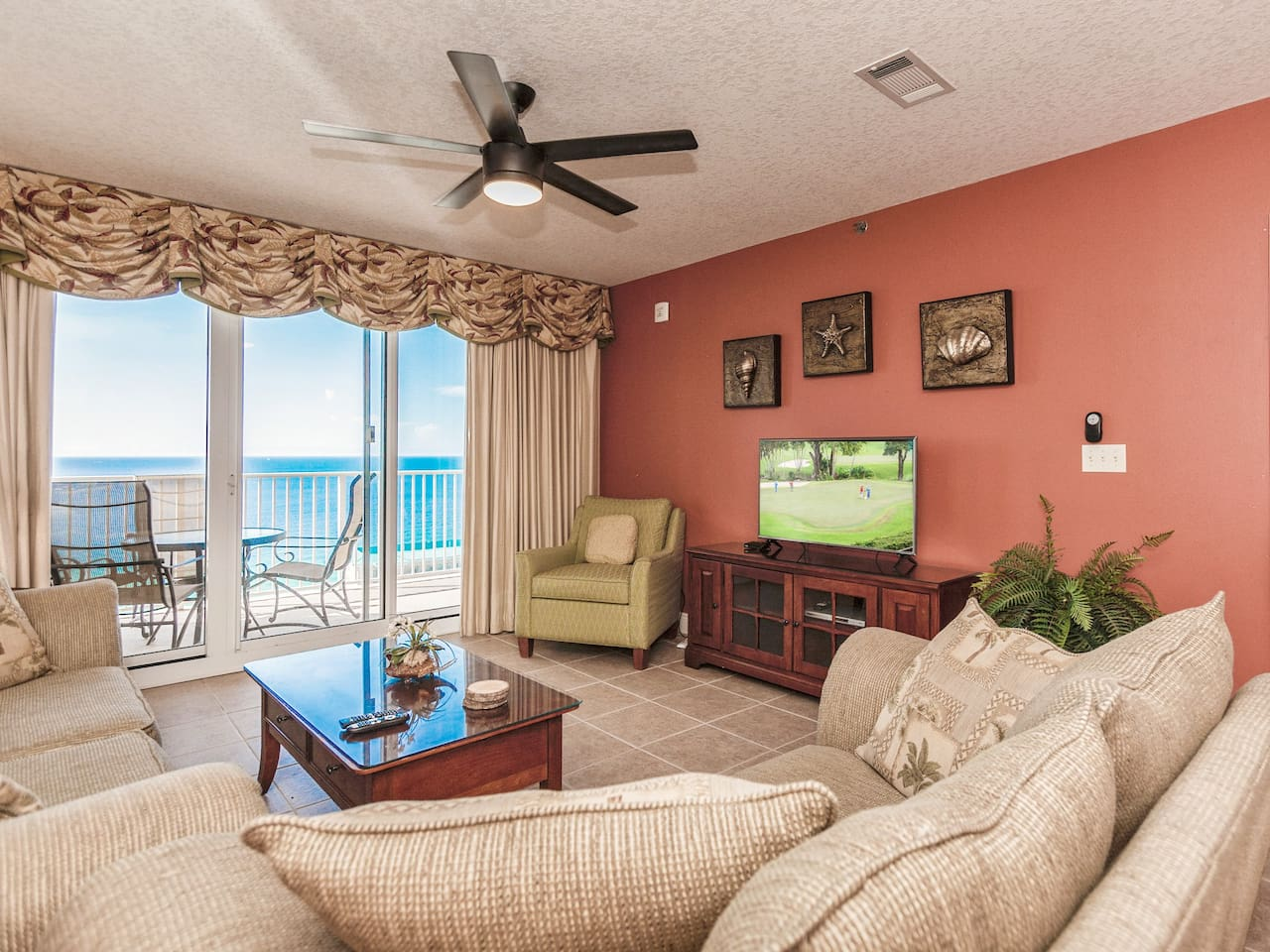 Welcome to Miramar Beach! Large glass doors provide sweeping views in the living room.