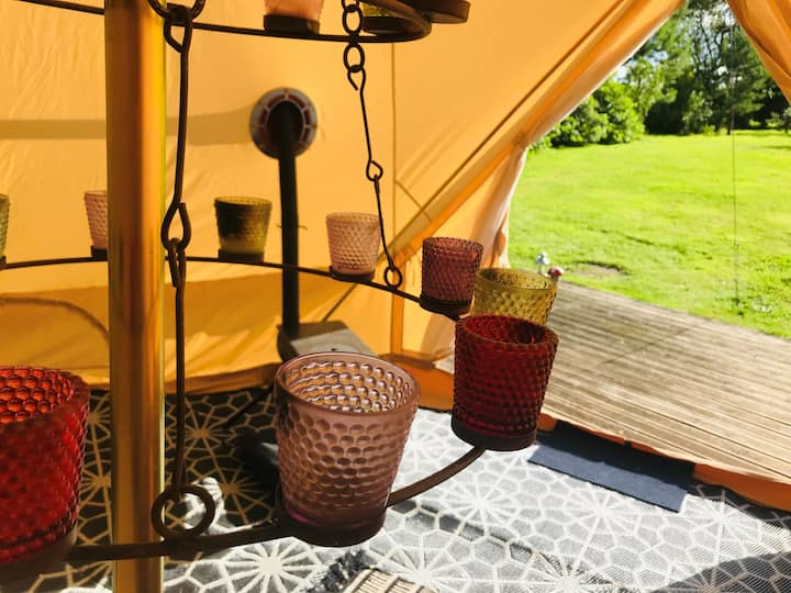 Eclipse, a bell tent in field and woodland.