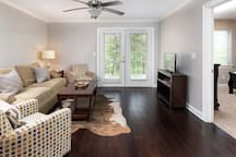 Spacious living room with large patio for entertaining.  Flat screen TV with full cable and high-speed internet.