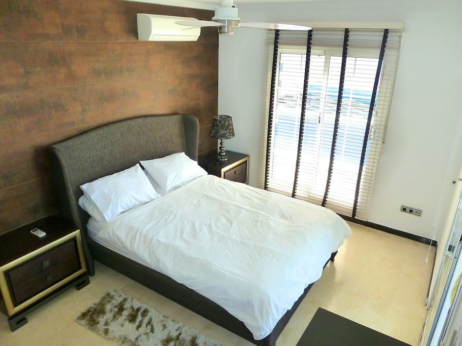 U3: UPSTAIRS BEDROOM 3. This is the bedroom that possibly makes the most of the mesmerising views of this superb property. As it is on the corner of the villa, the French windows lead to the swimming pool and jacuzzi area on one side, and to the main terrace on the other. Waking up to these direct views of the Mediterranean sea is a priceless experience.