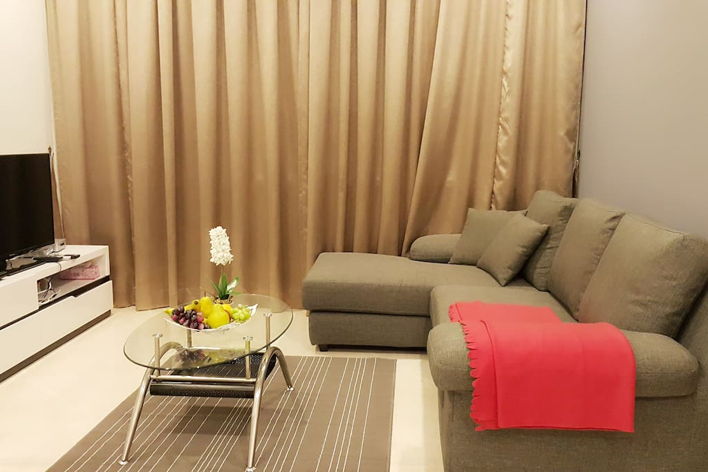 Comfortable L-Shape Sofa at Living Room.  Flat Screen TV and DVD Movies for your Entertainment