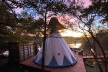 A view from the back of the teepee at sunrise, overlooking the lake.  Photo donated by a recent guest.