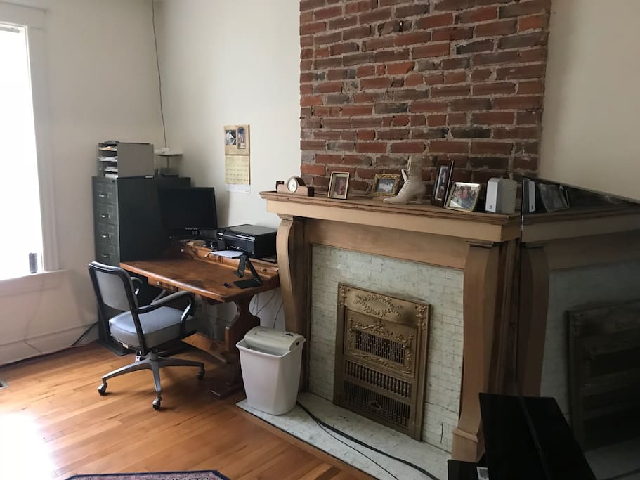 Desk and fireplace