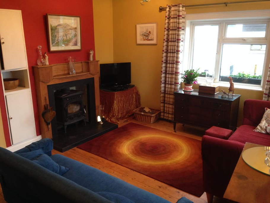 Cosy living room with wood fire stove, TV (net flicks, DVD) and Piano.