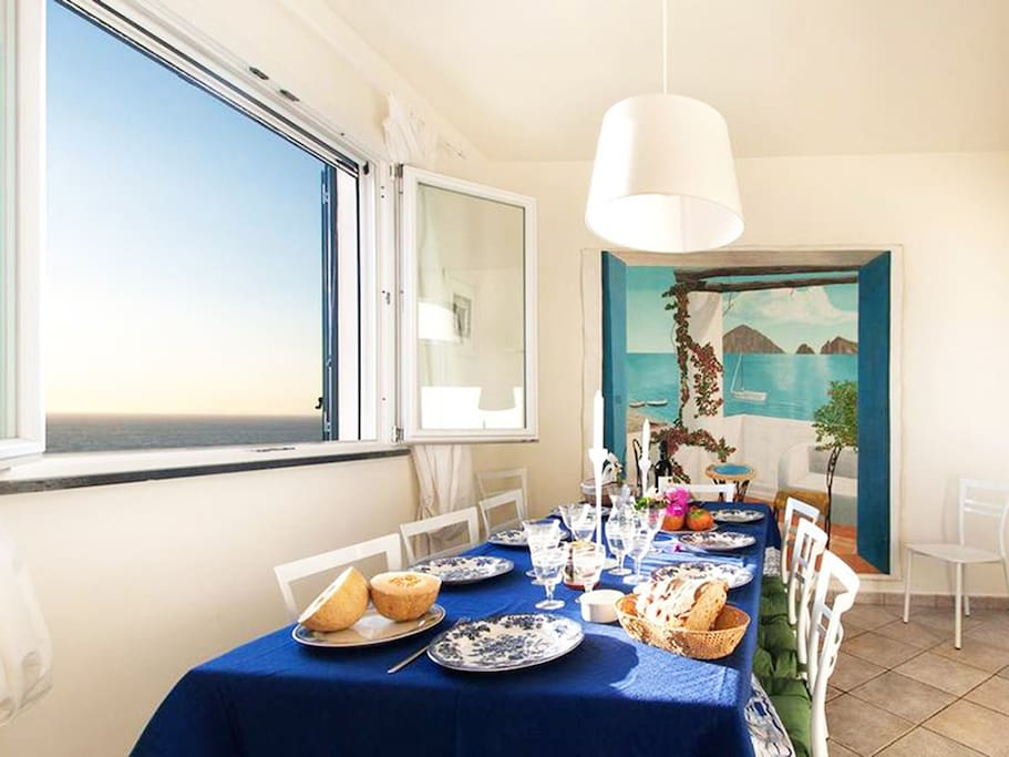 Dining area and access to terrace with  ocean and Isle of Capri view at San Montano - Massa Lubrense