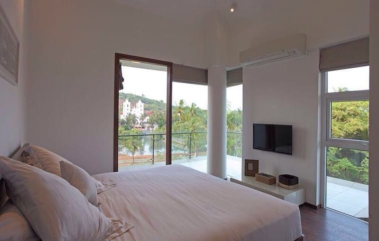 Master bedroom with view of Lady Of Hope church