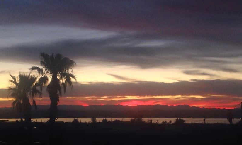 "THE ACTUAL VIEW FROM THE HOUSE, OR WHILE HAVING A BITE TO EAT!!! THE BEST SPOT IN ALL OF HAVASU FOR SUNSETS IS FROM ""YOUR LIVING SPACE""!"