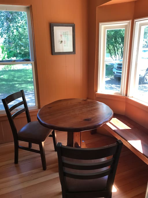 Kitchen nook. Custom made table and bench from reclaimed redwood.