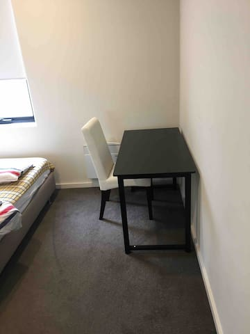 A chair and desk are provided in your room.