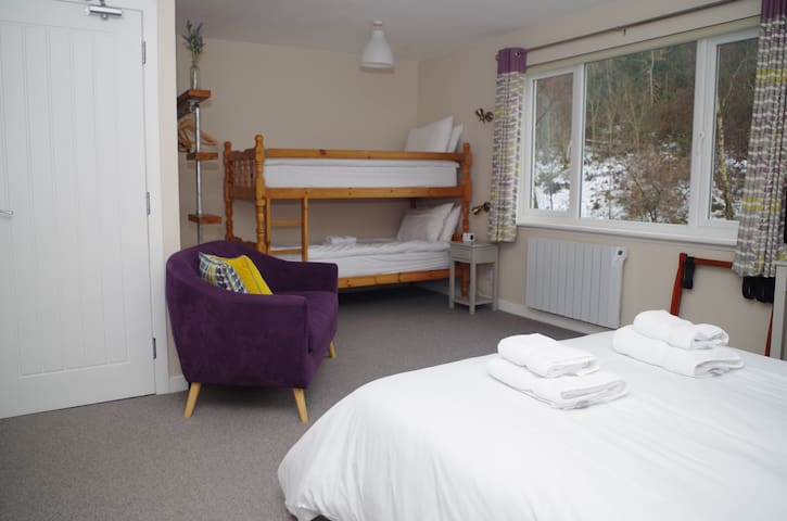 Recently refurbished in modern vintage style, our large family room with double bed and bunk beds, and space for a fold down bed for a fifth person.