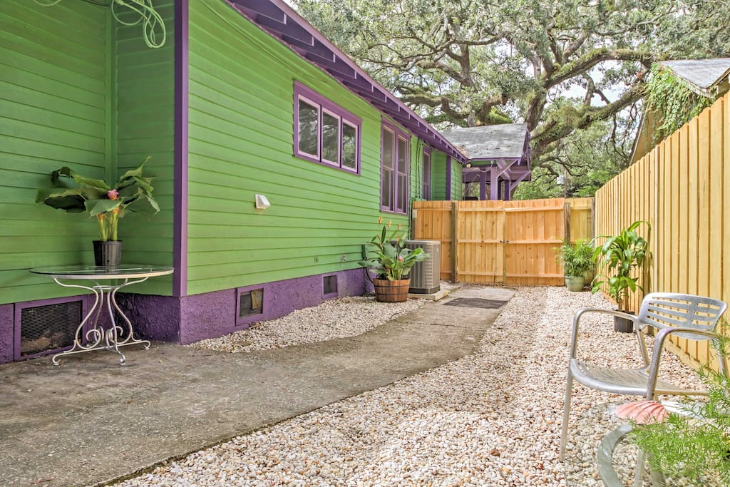 The historic home has a large, fenced-in backyard.