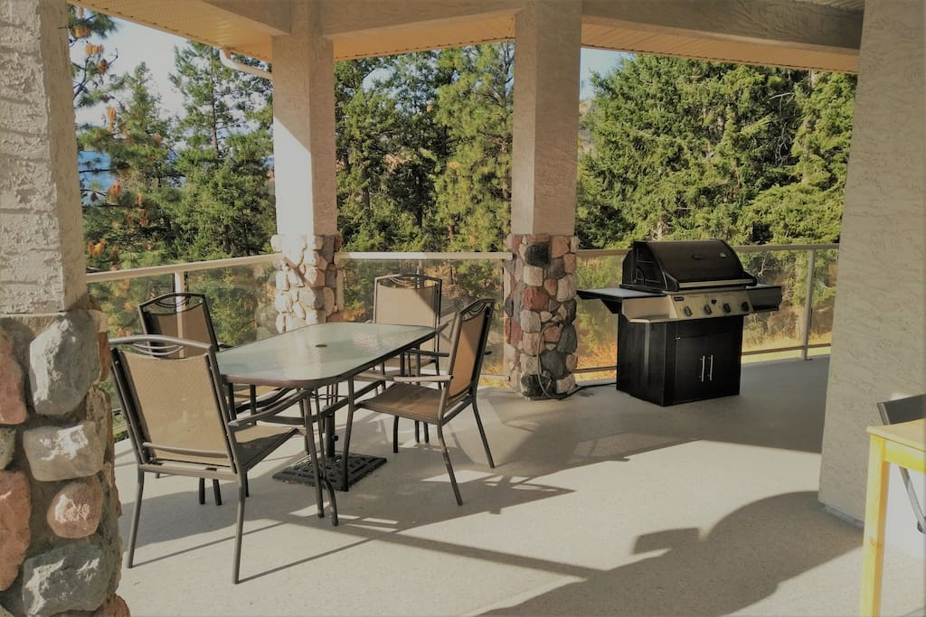 Enjoy an outdoor barbecue on the large covered deck.