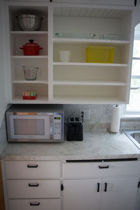 Brand new microwave, toaster, and cooking tools/dishes