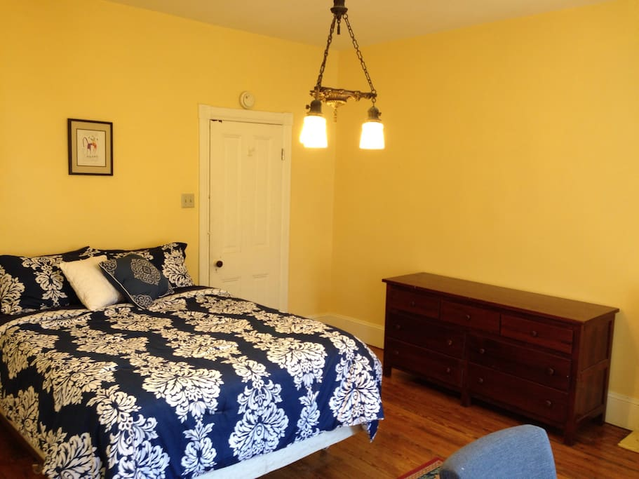 Queen size bed with new memory foam and spring mattress.