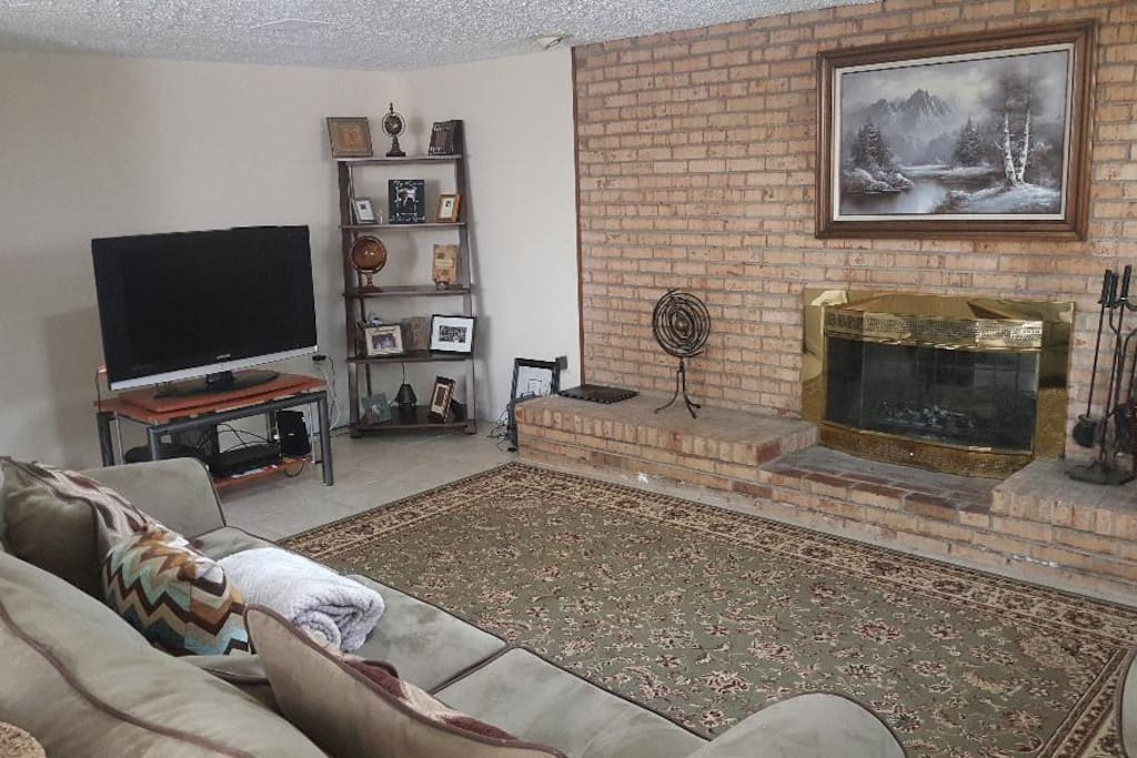 Family room with fireplace and tv for family time or relaxation