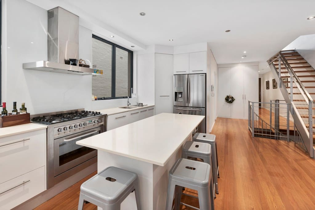 Modern Gas kitchen  and pollished floors throughout