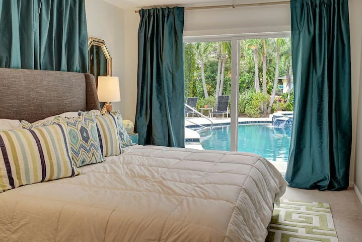 Sumptuous Master Suite with King Tempurpedic mattress, luxury linens, spa bathroom, custom walk-in closet and direct access to the pool