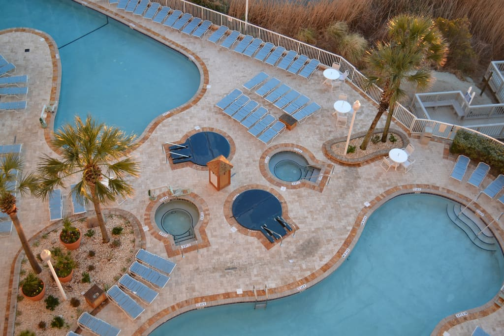 Side view from balcony of pools and hot tubs