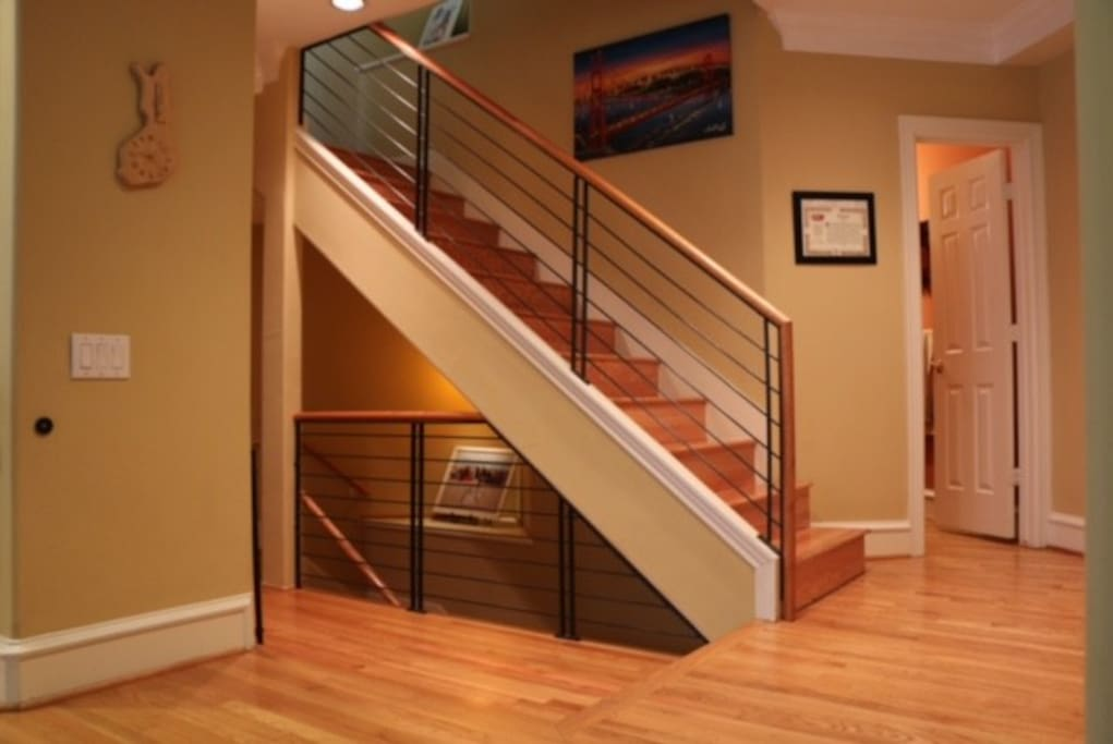 Staircase with half bath shown