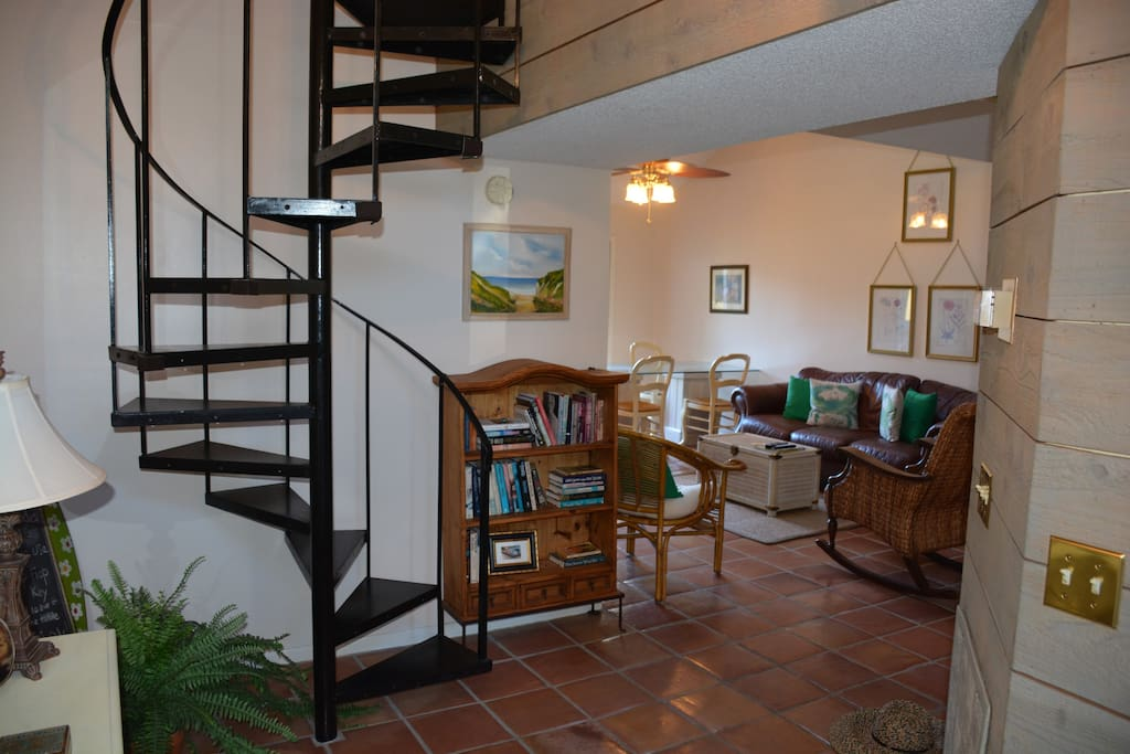 Entry with view of spiral staircase to upstairs bed and bath