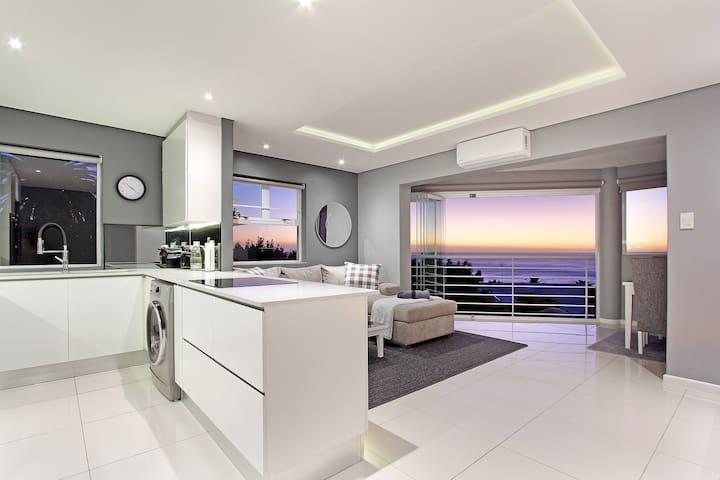 Sleek Designer Home with Mountain + Sea views