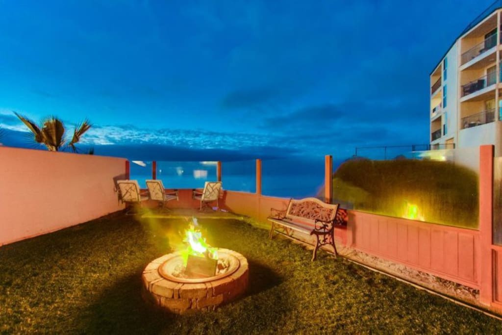 A fire at twilight, with the expansive Ocean View in the background, creates the ideal evening for romance, or a family Marshmallow roast