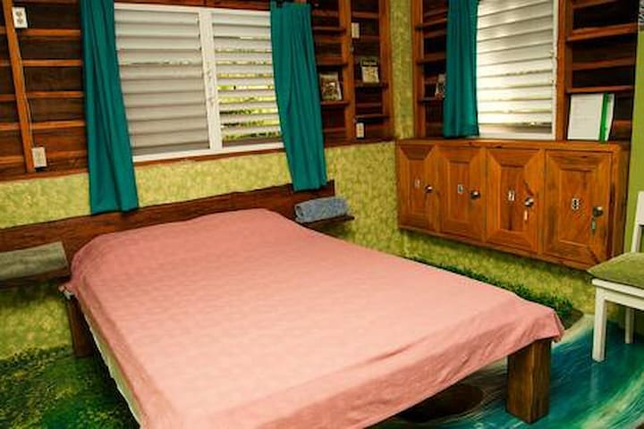 The same setup at the River Room - a queen bed and a bunk bed