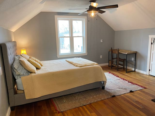 The bedroom has a queen bed, view of the barnyard and 125+ year old stables. There are sliding doors to offer privacy between the bedroom and the loft.