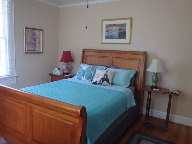 Comfy Queen Bed, ceiling fan in the room.  Linens may change with the season.  Information on the local restaurants beside the bed.