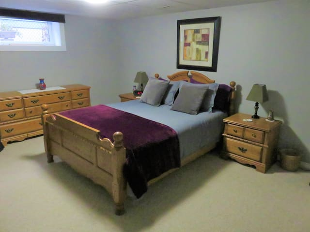 Large bedroom with a comfy queen size bed.