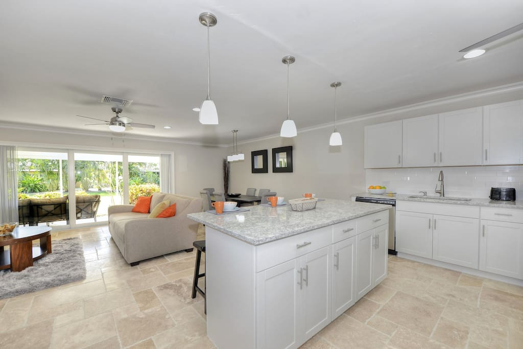 Open living, kitchen island, view to greenbelt