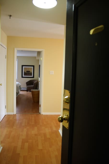 Entrance to the condo. Jacket closet then bathroom on your left. Bedroom 1 straight ahead.