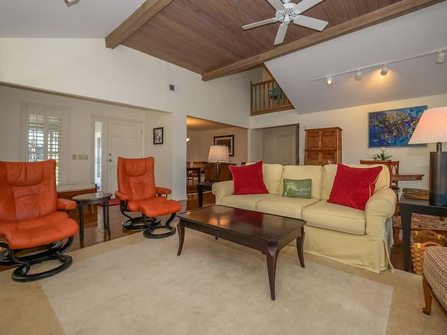 Living Room Opens to Dining Area and Offers Access to Back Deck at 44 Lands End