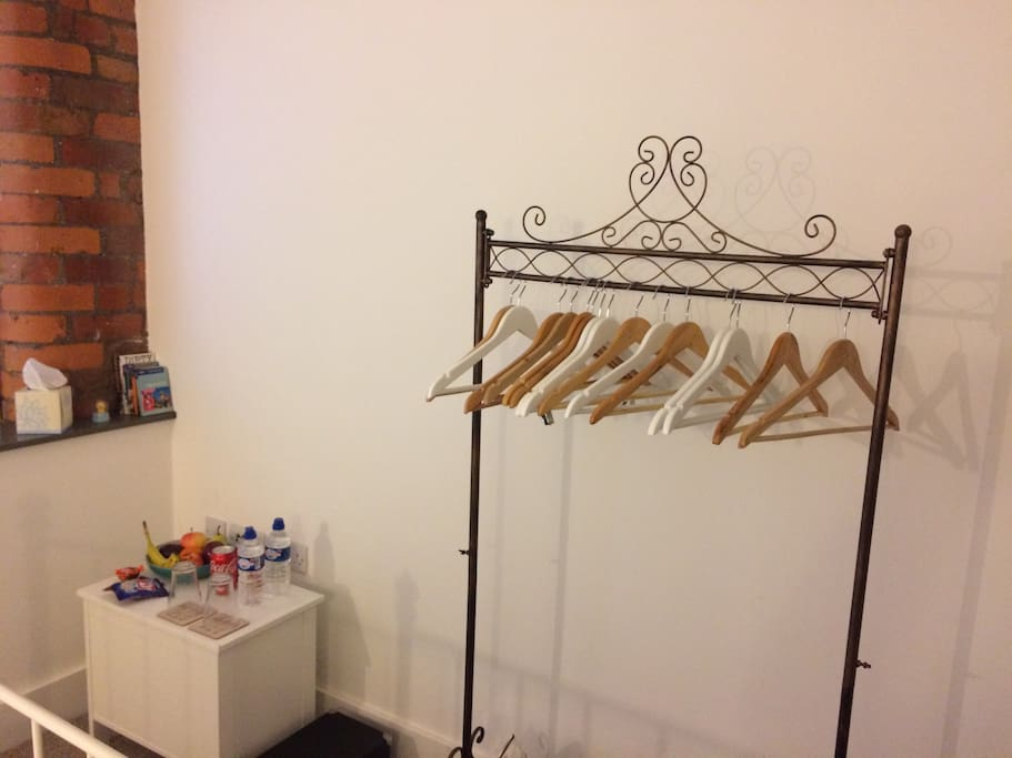 Clothing rail and hangers. Storage unit with snacks, drinks and fruit on top of it :-)