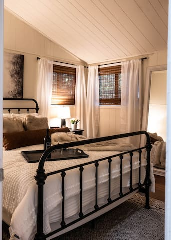 The spacious main bedroom can sleep up to 2 adults and has a queen bed and 40 inch LCD TV and closet to hang clothes. The bed has been updated with luxurious, fluffy white bedding.