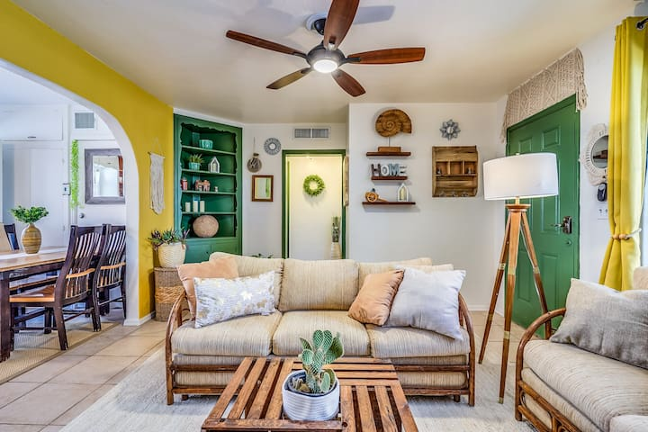 Colorful and bright living room with air conditioning that sits 7 people for those late-night games and Netflix.