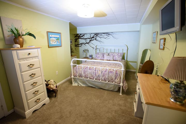 Large bedroom with work or sitting area, great for corporate guest traveling through the area!