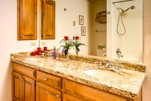 Master BA with granite counters, tile floor, and large jetted tub and shower