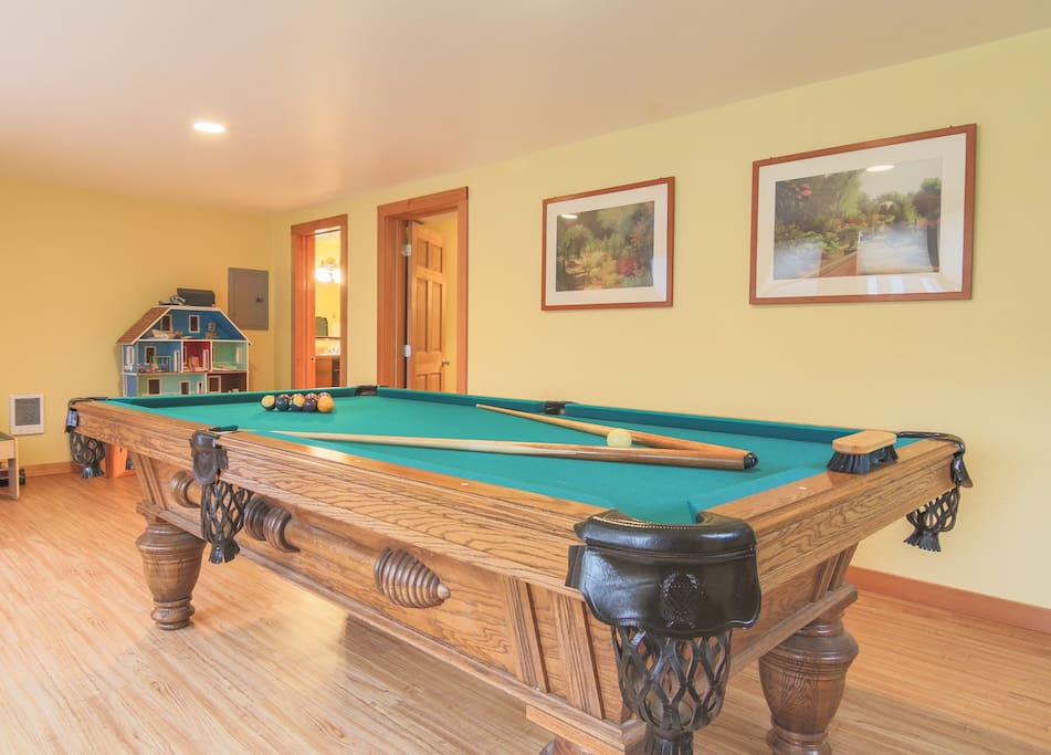 People love our extra large 8 foot slate pool table with ping pong table top in the recreation room.