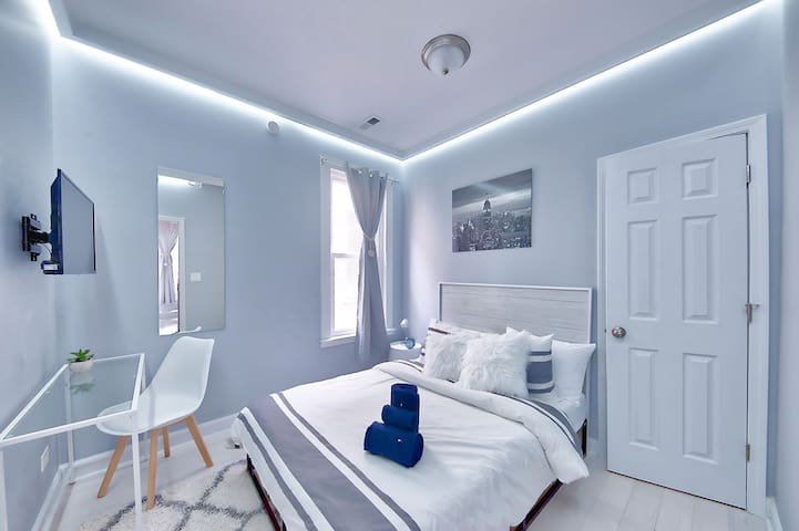 """Bedroom #1: Soft Indirect LED lighting allows you to ease into the evening (supplement to overhead lamp). Plush 8"""" Zinus memory foam double mattress & memory foam pillows to optimize your sleep comfort"""