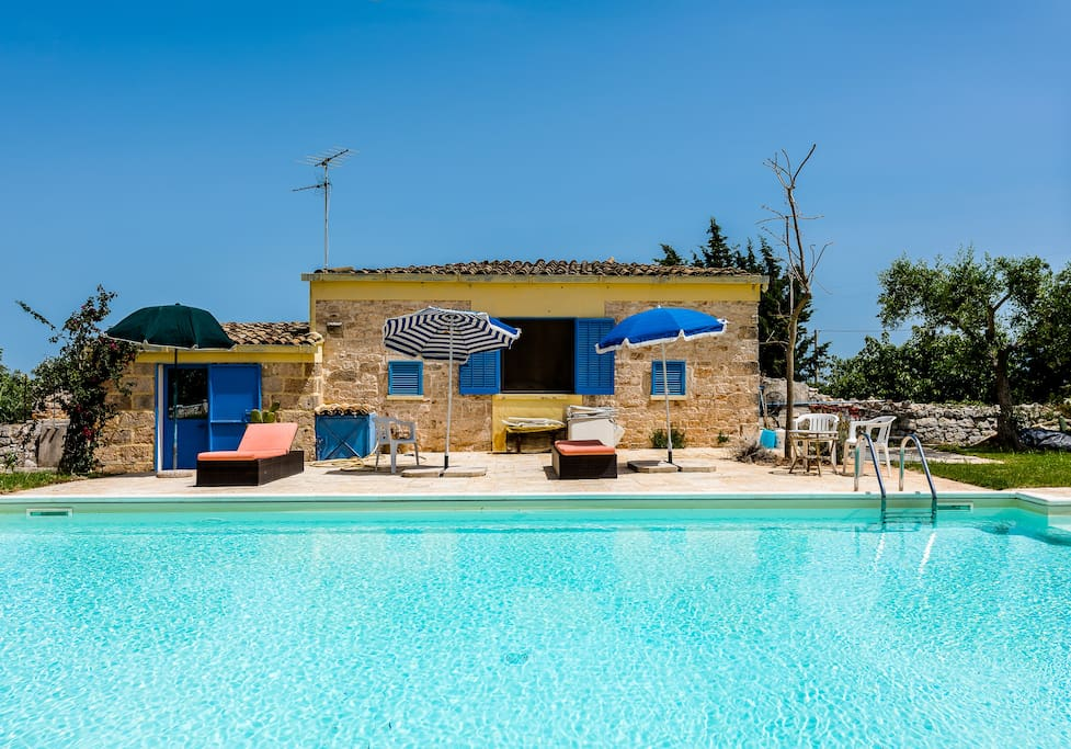 pool house: it's a lovely double bedroom and half bathroom with outdoor shower over looking the pool