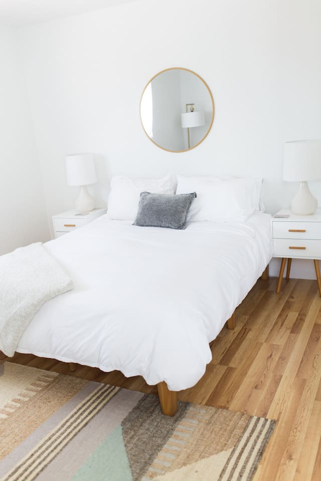Queen size bed and extra pillows