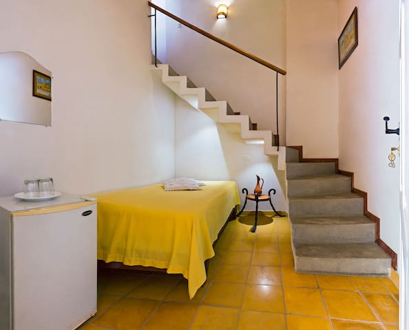 Mustard duplex room with staircase